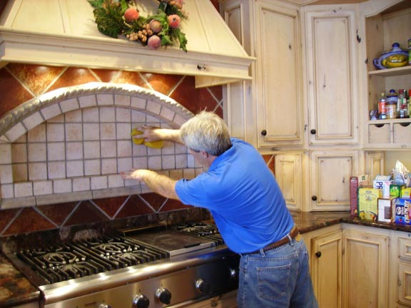 David cleaning a tile back splash